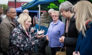 Theresa May meeting shoppers and stall holders at Abingdon market in Oxfordshire.