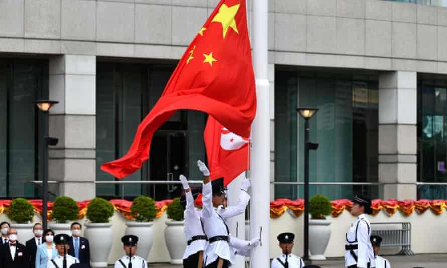 The Chinese and Hong Kong flags are released during the flag-raising ceremony.