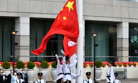 The Chinese and Hong Kong flags are released during the flag raising ceremony.