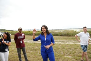 Tulsi Gabbard waves to supporters in North Charleston, South Carolina, on 5 October.