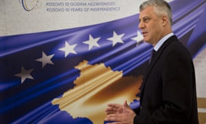 Kosovo's president, Hashim Thaçi, stands in front of a banner marking the 10th anniversary of Kosovo independence