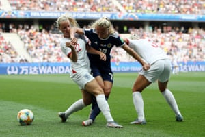 Beth Mead and Alex Greenwood of England put pressure on Claire Emslie of Scotland.