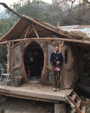 Connor Jones stands outside a structure on his farm.