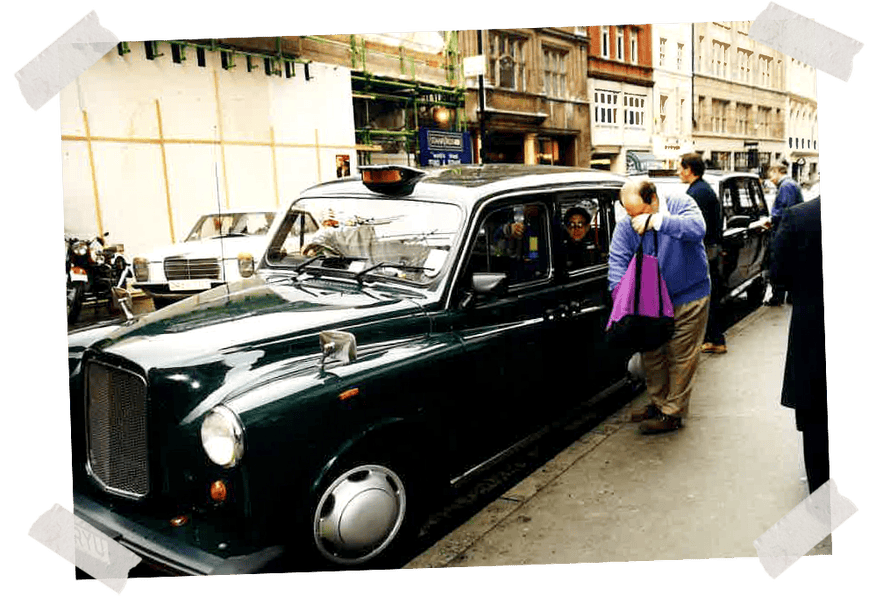 Dad opening his tote bag next to a London taxi, late 1990s.