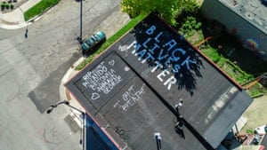Minneapolis, Minnesota, US A message to aliens from Earth? The site of the death in Minneapolis has an urgent message. Go tell it to the furthest galaxies: Black Lives Matter. It doesn't take a portrait or a mural to get the message across. Writing on the roof conveys the universality and urgency of what needs saying. You feel the anguish in the effort.