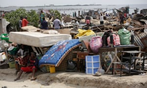 Residents salvage objects from houses demolished by government officials in Otodo-Gbame waterfront in Lagos.