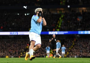 Aguero reacts after missing a chance.