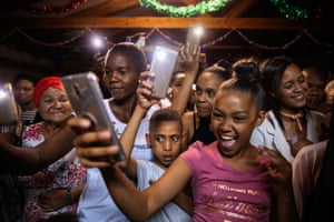 Girls and boys take pictures of a school play at a primary school in Pretoria, South Africa