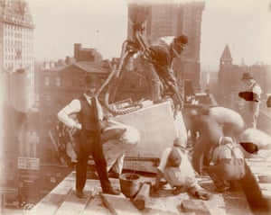 Construction workers on roof of the Central building of the New York Public Library, looking east,1906