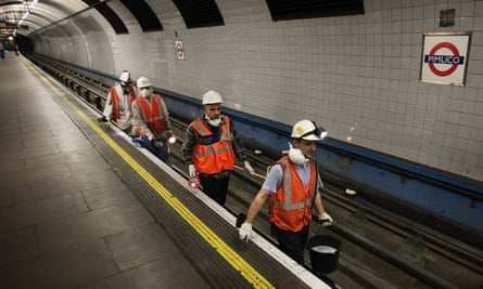 Cleaners at Pimlico station on the Victoria line
