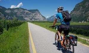 Man riding on the Adige cycle track near Salorno