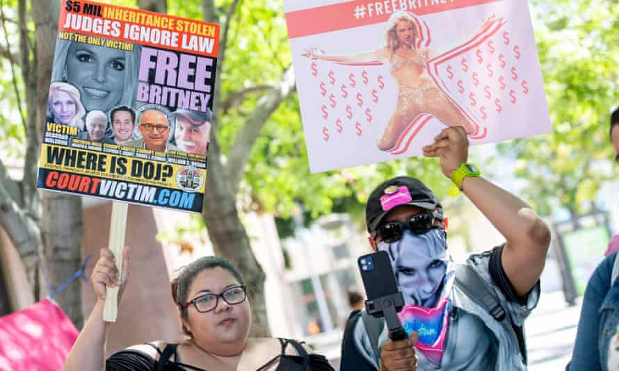 Fans and supporters of Britney Spears outside the LA county courthouse last week. The singer has implied she ultimately wants the conservatorship terminated but that her top priority for now is ousting her father from his role.
