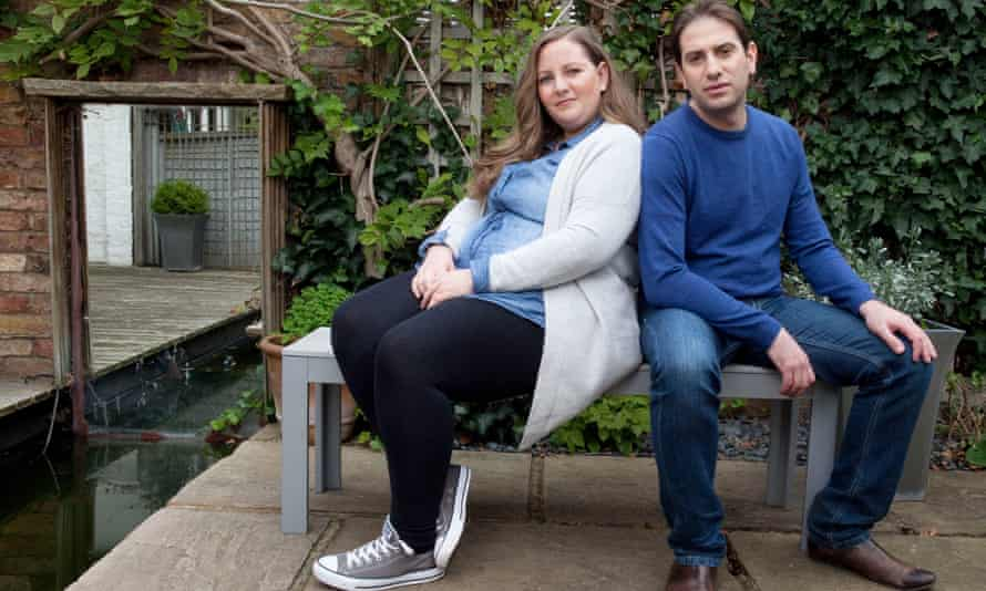 Rebecca and Charles sitting on a bench in their garden in London