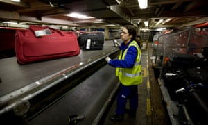 A baggage handler at Terminal 3, Heathrow airport.