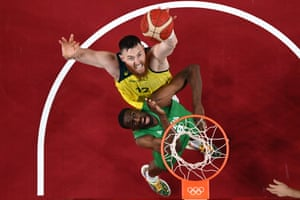 Aron Baynes (top) goes to the basket as Nigeria's Ekpe Udoh reacts in the men's preliminary round group B basketball match between Australia and Nigeria