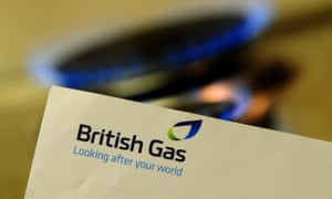 a British Gas bill and a blue-flamed gas ring burning in the background