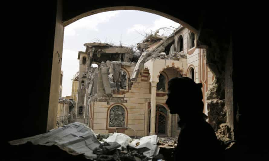 A Yemeni militiaman in the ruins of the house of a commander loyal to the Houthis after it was hit by two airstrikes allegedly carried out by the Saudi-led coalition in Sana''a.