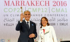 French environment minister, Ségolène Royal, hands over stewardship of the climate forum to Moroccan foreign minister, Salaheddine Mezouar.