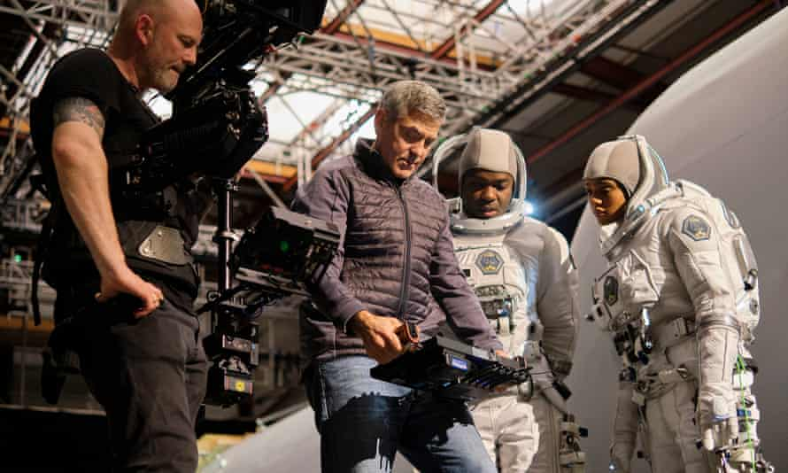 George Clooney on set at Shepperton Studios with David Oyelowo and Tiffany Boone on his film, The Midnight Sky another post-apocalyptic sci-fi project.