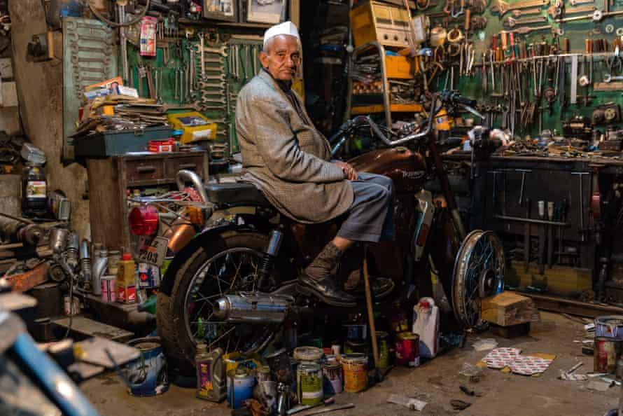 A motorbike mechanic in Mussoorie's Landour Bazaar