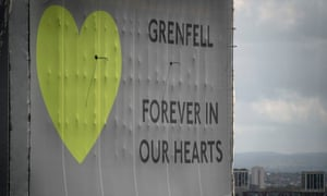 A banner wrapped around Grenfell Tower