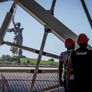 The Motherland Calls statue is seen through the structure of the Volgograd Arena.