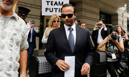 George Papadopoulos with his wife Simona Mangiante leaves after his sentencing hearing at US district court in Washington in September.