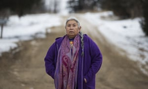 Faith Spotted Eagle stands outside of her home in Lake Andes, South Dakota