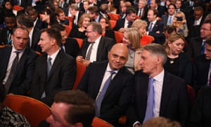 Members of the cabinet wait for Theresa May to give her keynote address