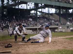 Babe Ruth slides into home plate, beating Muddy Ruel's tag, at Griffith Stadium in 1925.