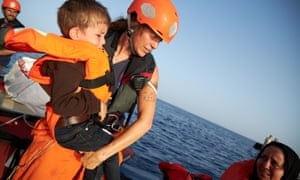 Sea-Eye rescues migrants off Libyan coast<br>epa07704798 A handout photo made available by German civil sea rescue organisation sea-eye shows a child being transferred from a boat carrying migrants to a rescue boat of sea-eye, in the Mediterranean Sea, 08 July 2019 (issued 09 July 2019). According to sea-eye, 44 people were rescued from a woodden boat floating in the Mediterranean between Malta and Lampedusa. The migrants were taken onboard the Alan Kurdi rescue vessel operated by sea-eye and are expected to be transferred to land by the Maltese Navy.  EPA/FABIAN HEINZ / SEA-EYE HANDOUT  HANDOUT EDITORIAL USE ONLY/NO SALES