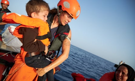 A child being transferred from a boat carrying migrants to a rescue vessel in the Mediterranean last July.