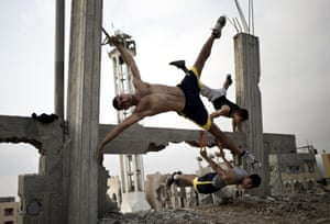 Members of the group Bar Palestine take part in street workouts, a form of exercise that is new to Gaza City