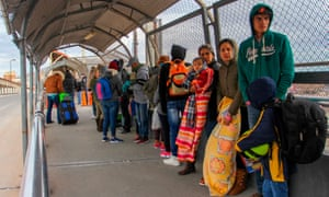 Migrants from Cuba, Venezuela and Central America queue at the Paso del Norte International Bridge in Ciudad Juarez, Mexico, to cross the border and request political asylum in the United States.