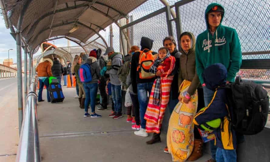 Migrants queue at the Paso del Norte International Bridge in Ciudad Juárez, Mexico, to cross the border and request political asylum in the United States.