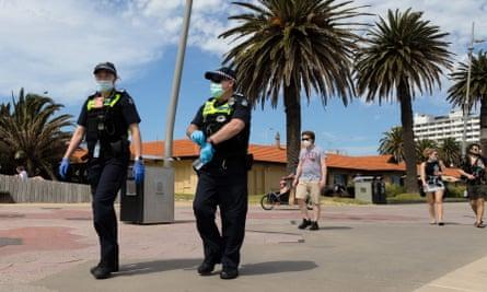Victoria police patrolling St Kilda beach in Melbourne.