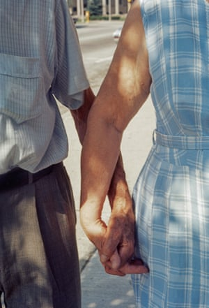 A close up of a man and a woman holding hands