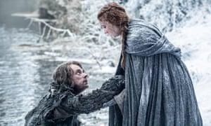 Alfie Allen as Theon Greyjoy and Sophie Turner as Sansa Stark in Game of Thrones.