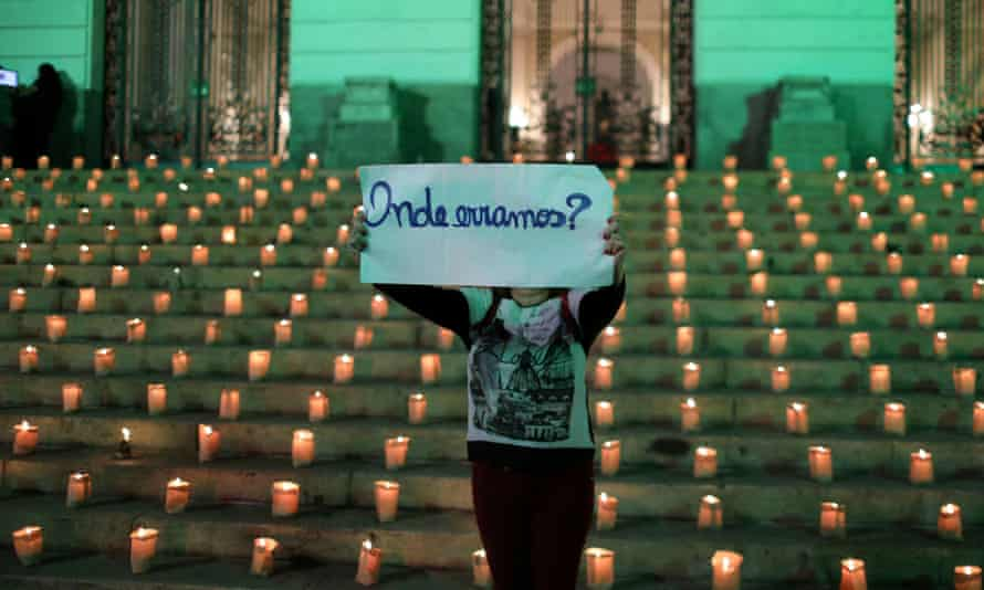 A woman holds a sign during an event to light candles in honour of the 500,000 people who have died from coronavirus in Brazil, in Rio de Janeiro this week. The sign reads: 'Where did we go wrong?'