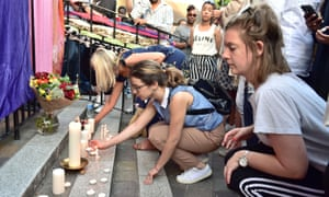 People light candles for the victims of the Grenfell fire, June 2017.
