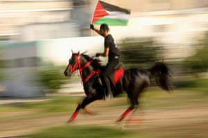 Gaza CityA rider holding the Palestinian flag takes part in the parade of horses march, organised by the Palestine Equestrian Federation to show solidarity with Jerusalem and the al-Aqsa mosque