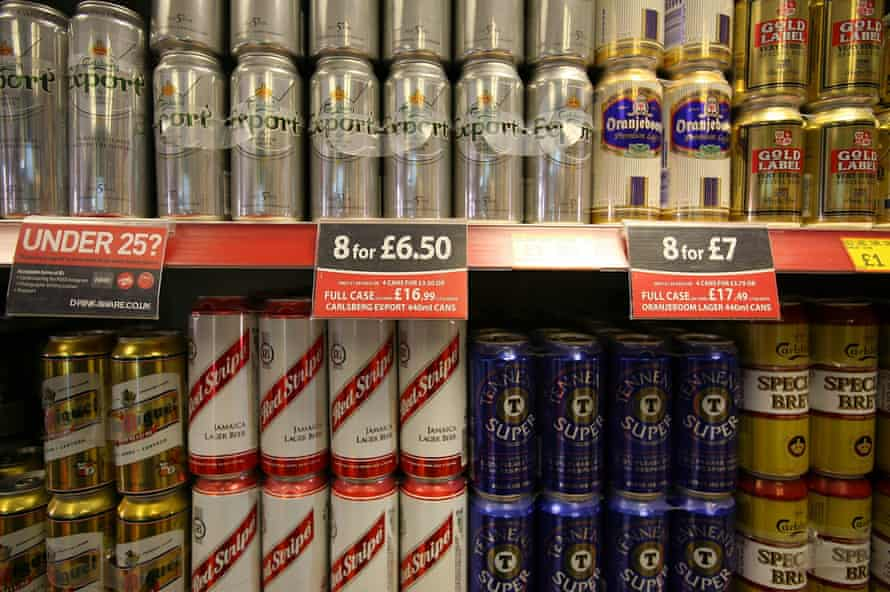 Cans of beer on display in an off-licence