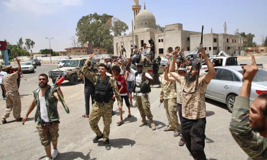 Libyan forces celebrate retaking the Qasr Bin Ghashir area of south Tripoli