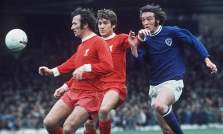 Tommy Smith, left, in action for Liverpool against Leicester City in 1971. The defender was known as the 'Anfield Iron' during a glittering spell at the club