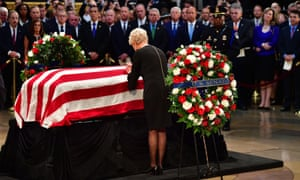Cindy McCain, John McCain's widow, pays her respects at her husband's casket inside the US Capitol rotunda in Washington DC, 31 August 2018.