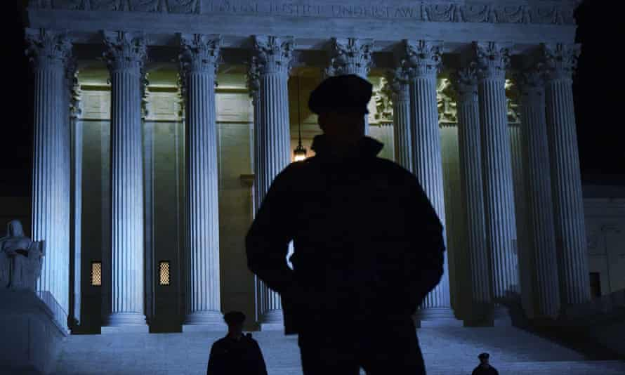 Police stand outside the supreme court in Washington.