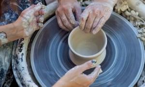 Making a pot on potter's wheel