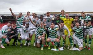 Celtic players celebrate winning last season's Scottish Premiership, their eight consecutive league title.