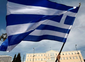 A Greek flag in front of the Athens parliament
