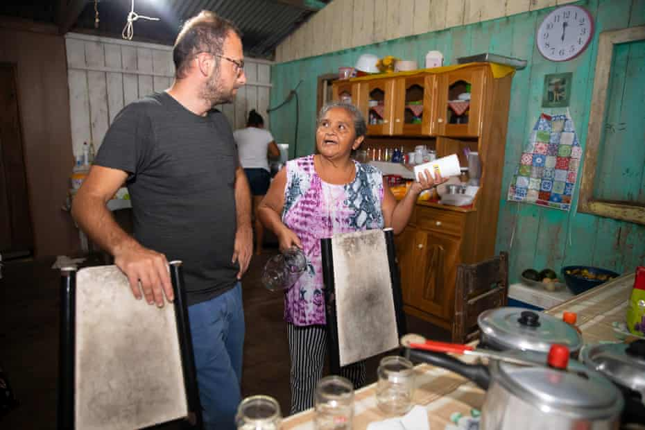 Kopp talks to Senhora Conda, whose home he stayed in while in the rainforest.